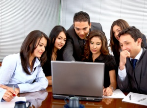 Employees gathered around a computer